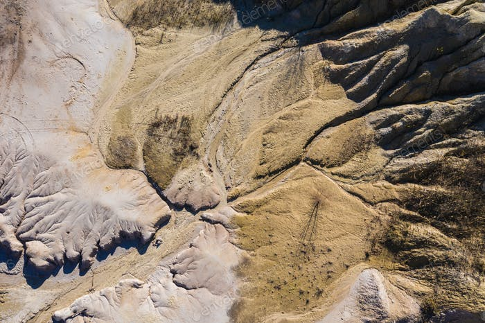 Surrealistic aerial image of abandoned opencast mine. Bad land pattern from a drone