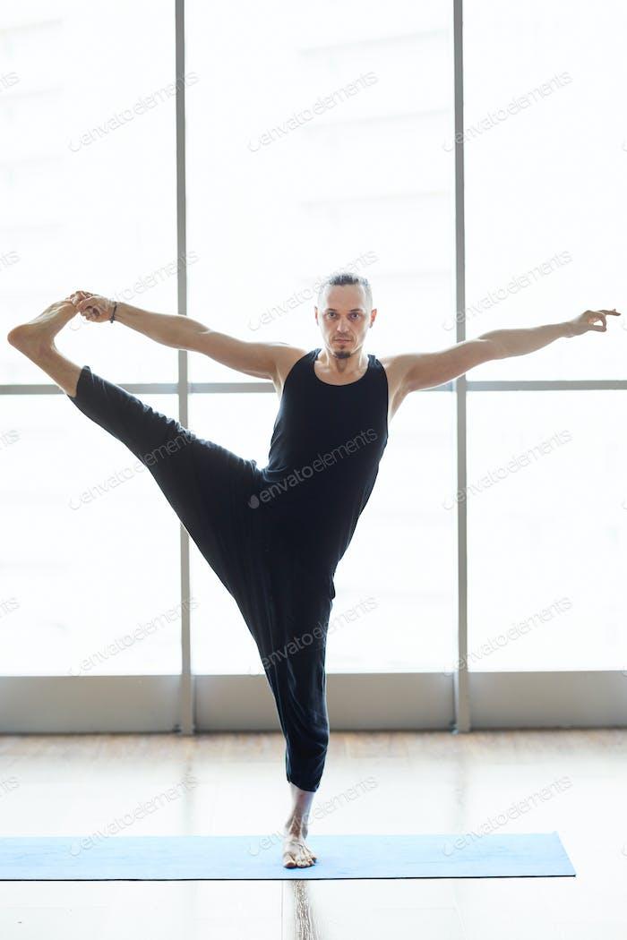 Yogis balancing on one leg