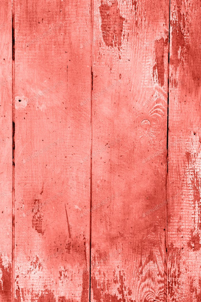 Living coral wooden background.