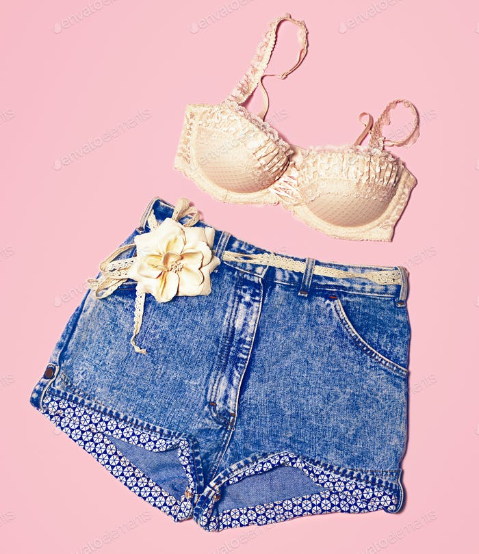 Sensual underwear and shorts on a pink background