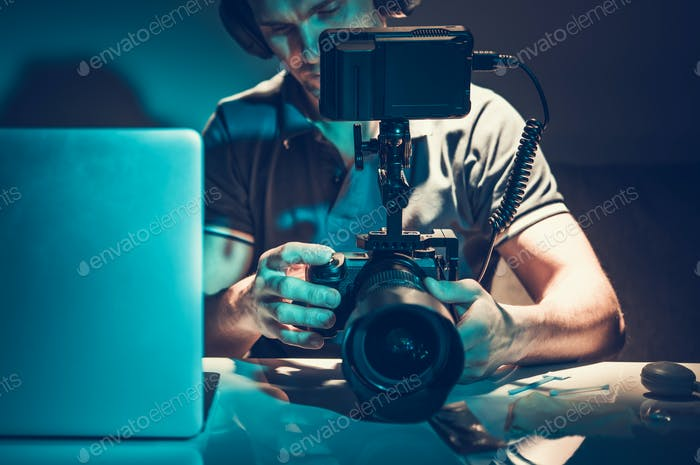 Camera Operator Reviewing Video Material on Display