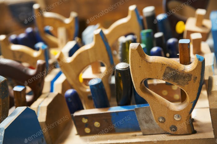 Close up of a woodworking tools in a boat-builder's workshop.