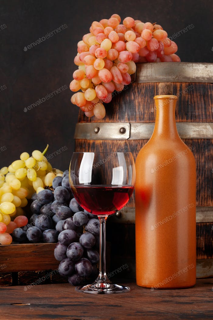 Wine bottle, grapes and glass of red wine