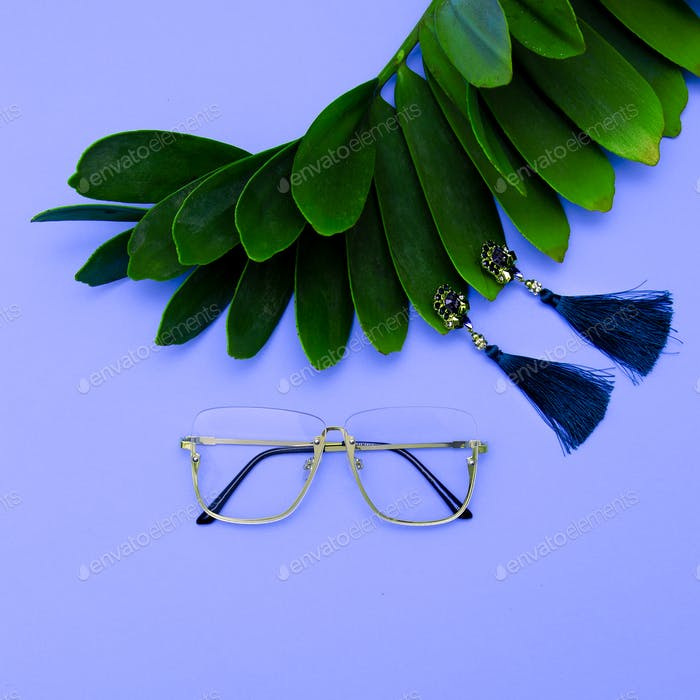 Glasses and Earrings. Stylish accessories for women. Flat lay