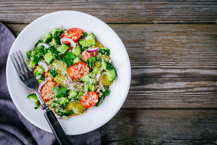 Quinoa Tabbouleh salad bowl with cucumbers, tomatoes, red onions and parsley