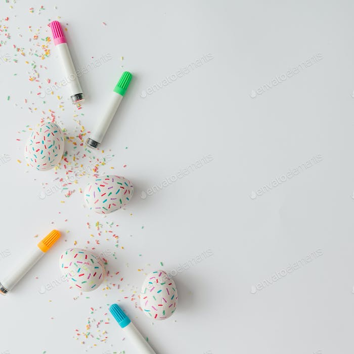 Creative arrangement of colorful Easter eggs with cake sprinkles. Minimal concept. Flat lay.