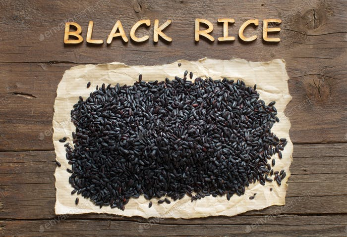 Black rice on a wooden table