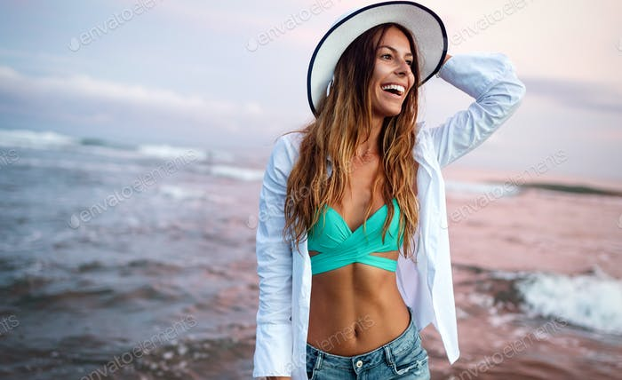 Beautiful woman on the beach during summer vacation
