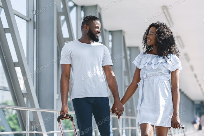 African couple in love enjoying first trip together