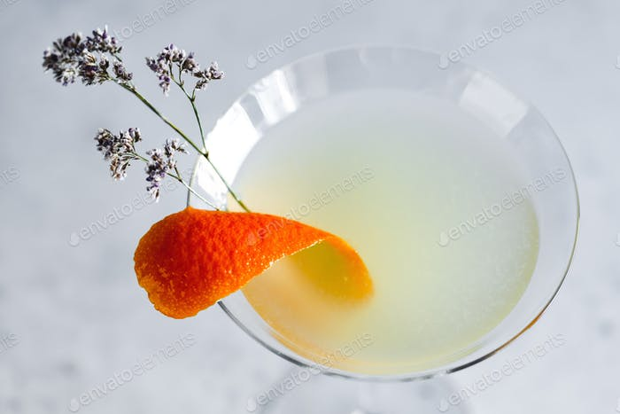Corpse Reviver No. 2 classic Cocktail with orange peel and flower.