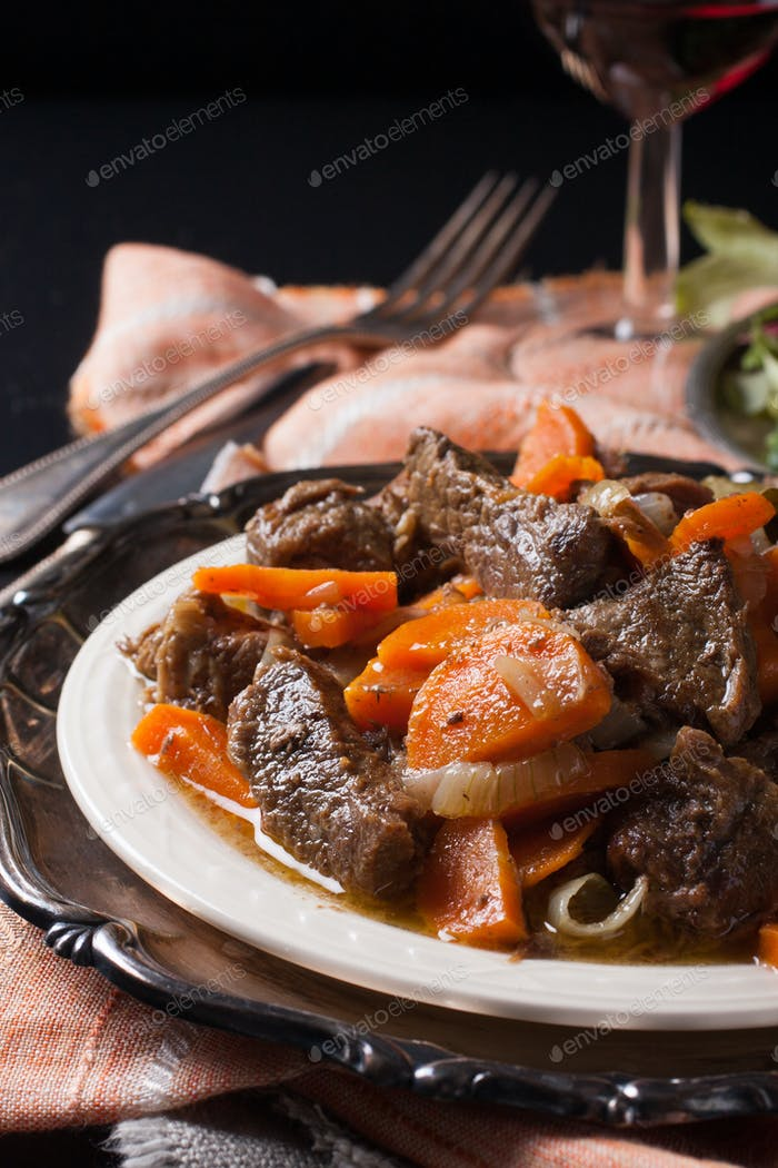 Plate of beef stew with a green salad