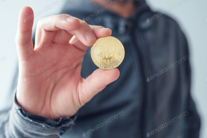 Man showing Bitcoin