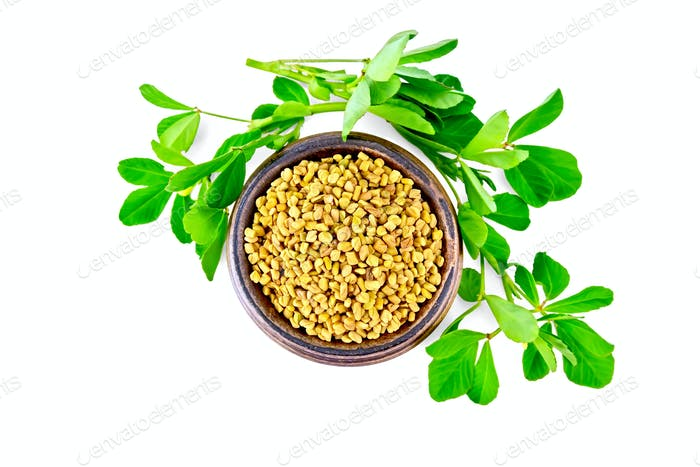 Fenugreek with green leaves in bowl on top