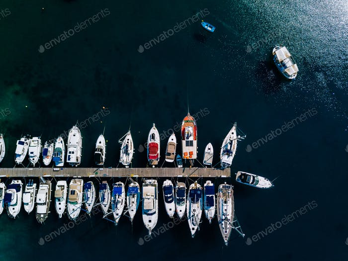 Aerial view of marina lot. Boats in the port in Greece.