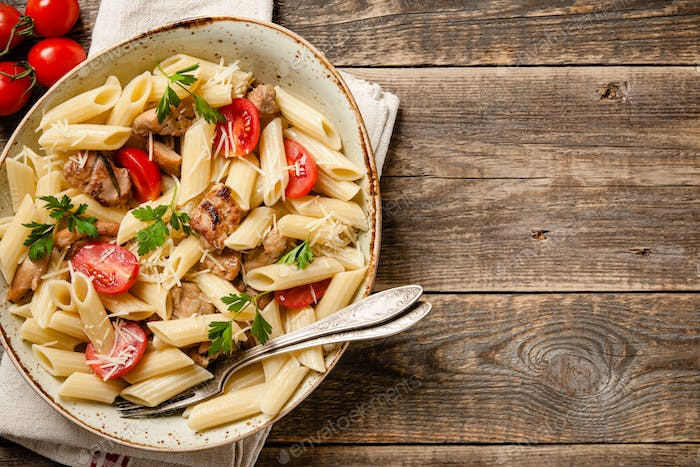 Penne pasta with chicken and tomatoes