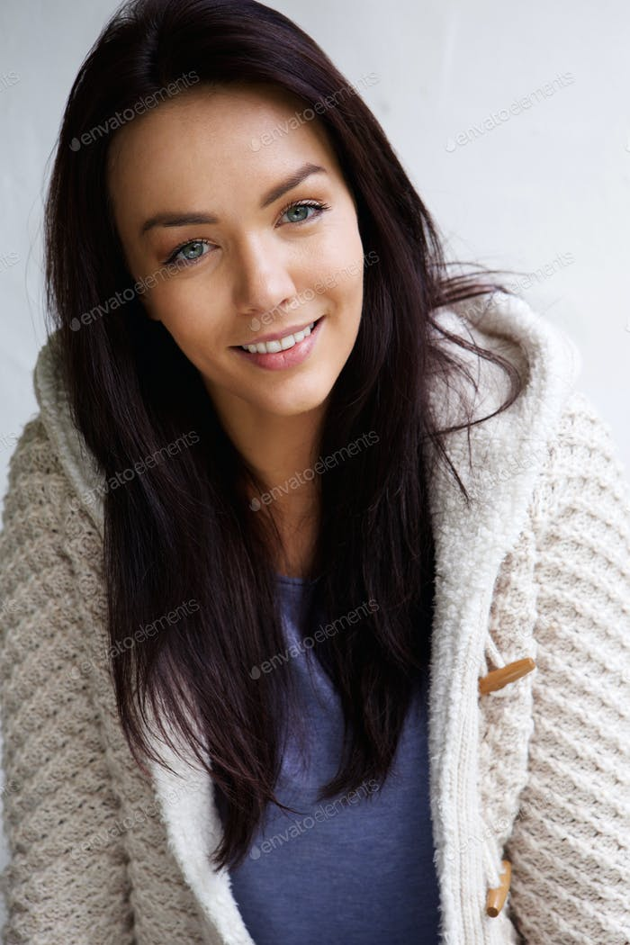 Beautiful young woman wearing a knitted sweater