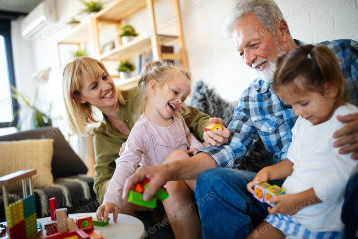 Senior grandparents playing with grandchildren and having fun with family