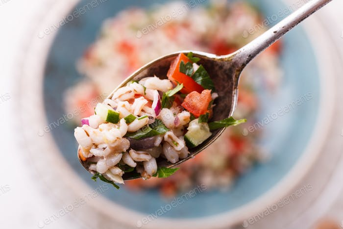 Salad with pearl barley and vegetables