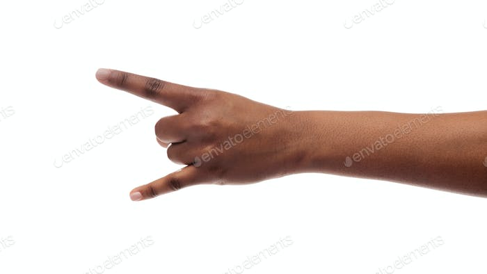 Black woman's hand making goat sign isolated on white background