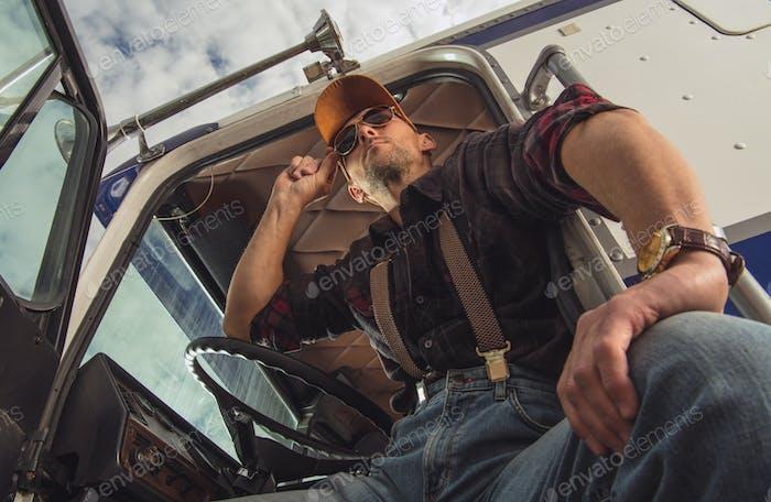 Truck Driver Taking Break At Rest Stop.