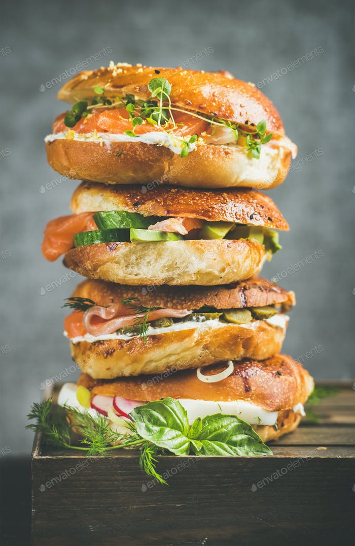 Heap of Bagels with salmon, eggs, vegetables, capers and cream-cheese