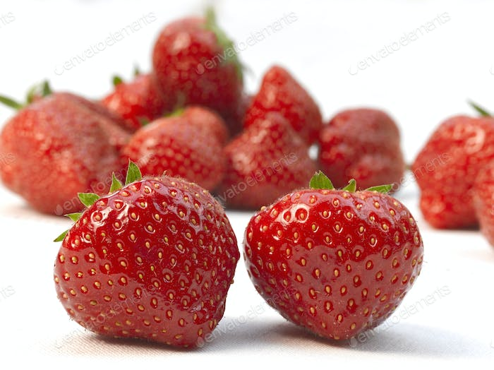 Two fresh ripe red strawberries