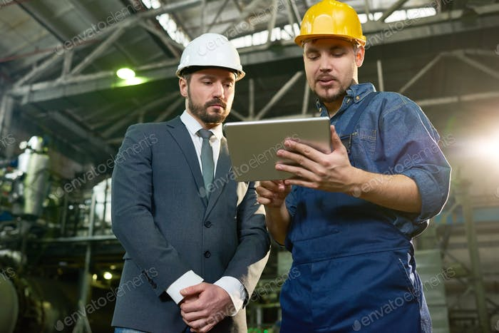 Worker Presenting Project to Businessman