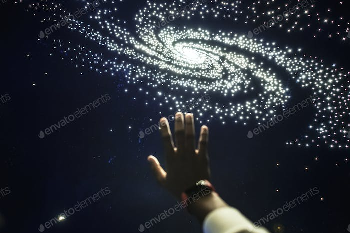 Man experiencing the universe at a planetarium