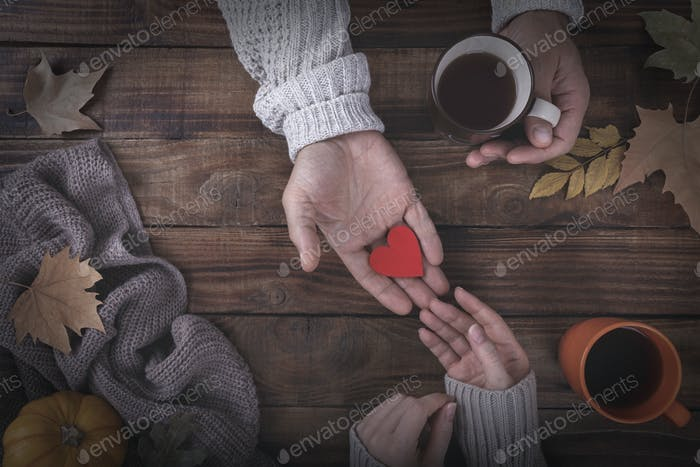 Loving couple holding a heart in hands