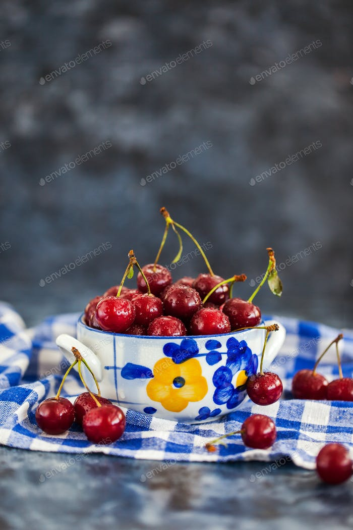 Fresh wet sour cherry in a bowl