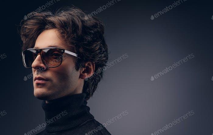 Studio portrait of a sensual macho male with stylish hair in a b