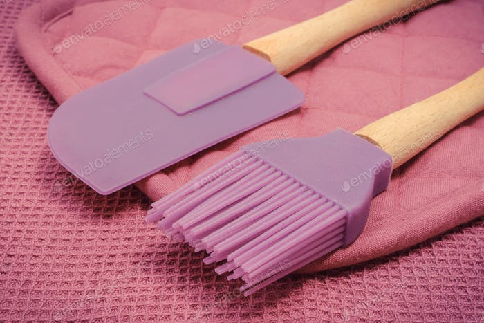 Closeup of silicone kitchen accessories, spatula and brush