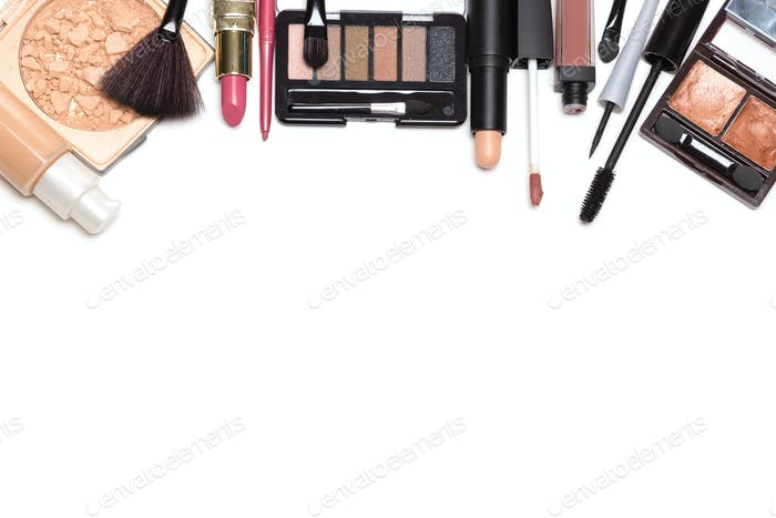 Beauty products for natural makeup on white with copy space