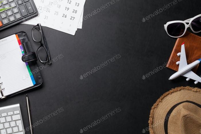 Business trip concept. Accessories on desk table