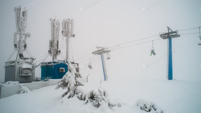 Snow-covered and ice-covered power plant