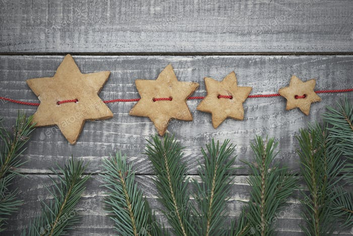 Gingerbread stars hanging on the twine