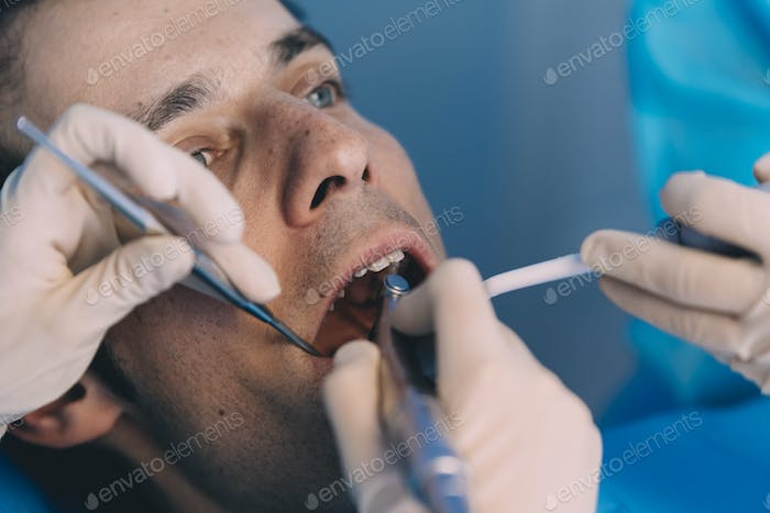 Dentists with a patient during a dental intervention