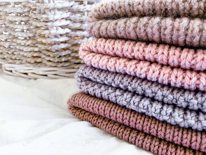 multicolored wool knitted hats in stack