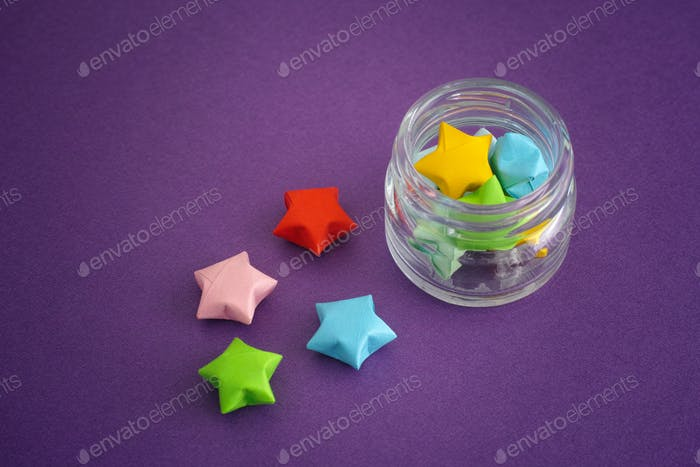 Thumbnail for Colorful origami lucky stars spilling out of a jar