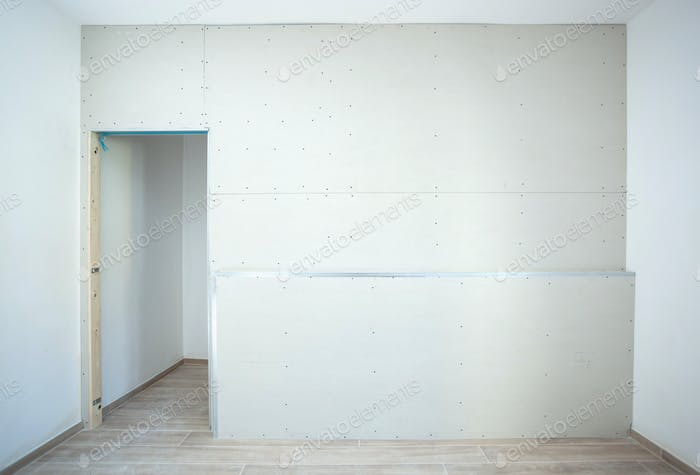Wall made of plasterboard for a wardrobe in a house.