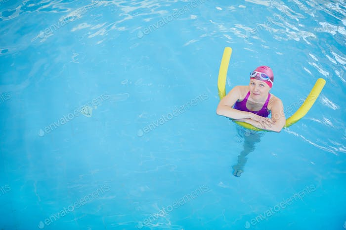 Senior Woman Relaxing in Pool