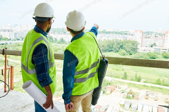 Construction engineers contemplating next residential district