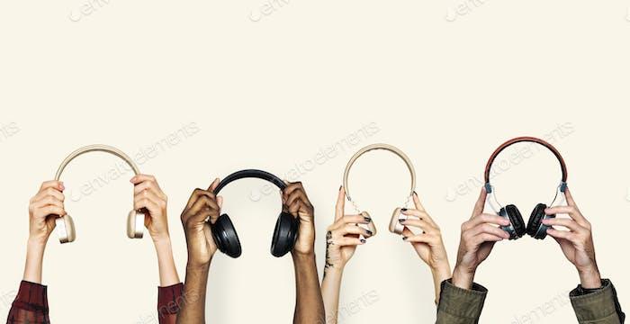 Diversity hands holding handset