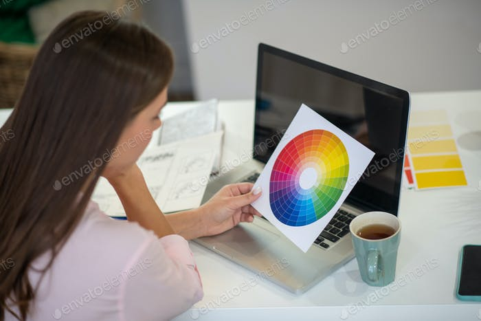 Close up of a color palette in female hands