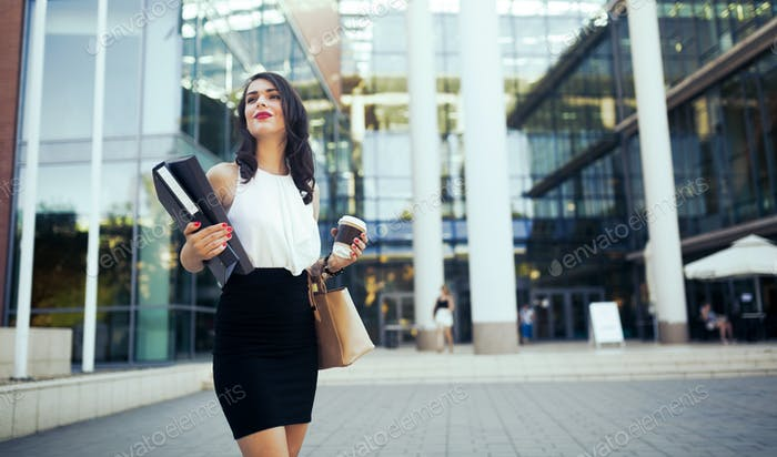 Businesswoman outdoors using phone