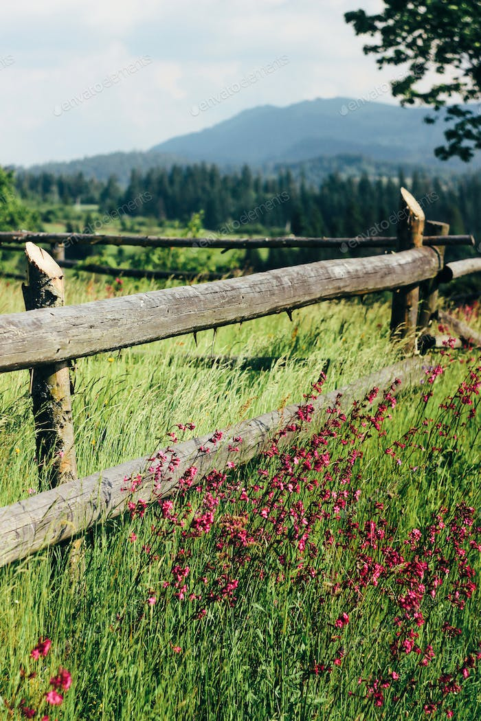 amazing beautiful view of mountains hills with wooden fence