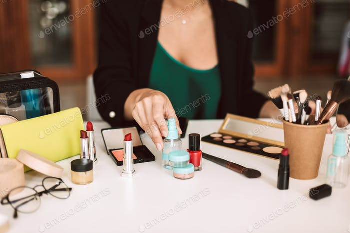 Close up beauty blogger talking about cosmetic products isolated