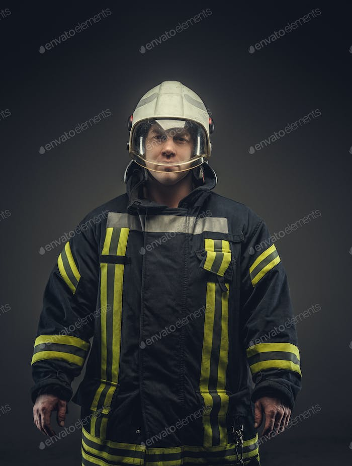 Portrait of male in firefighter costume.
