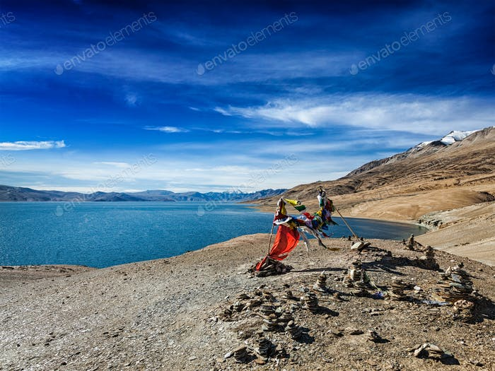 Buddhist prayer flags lungta at Himalayan lake