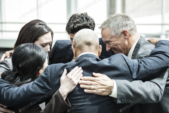 Mixed race group of business people in an informal team building meeting.